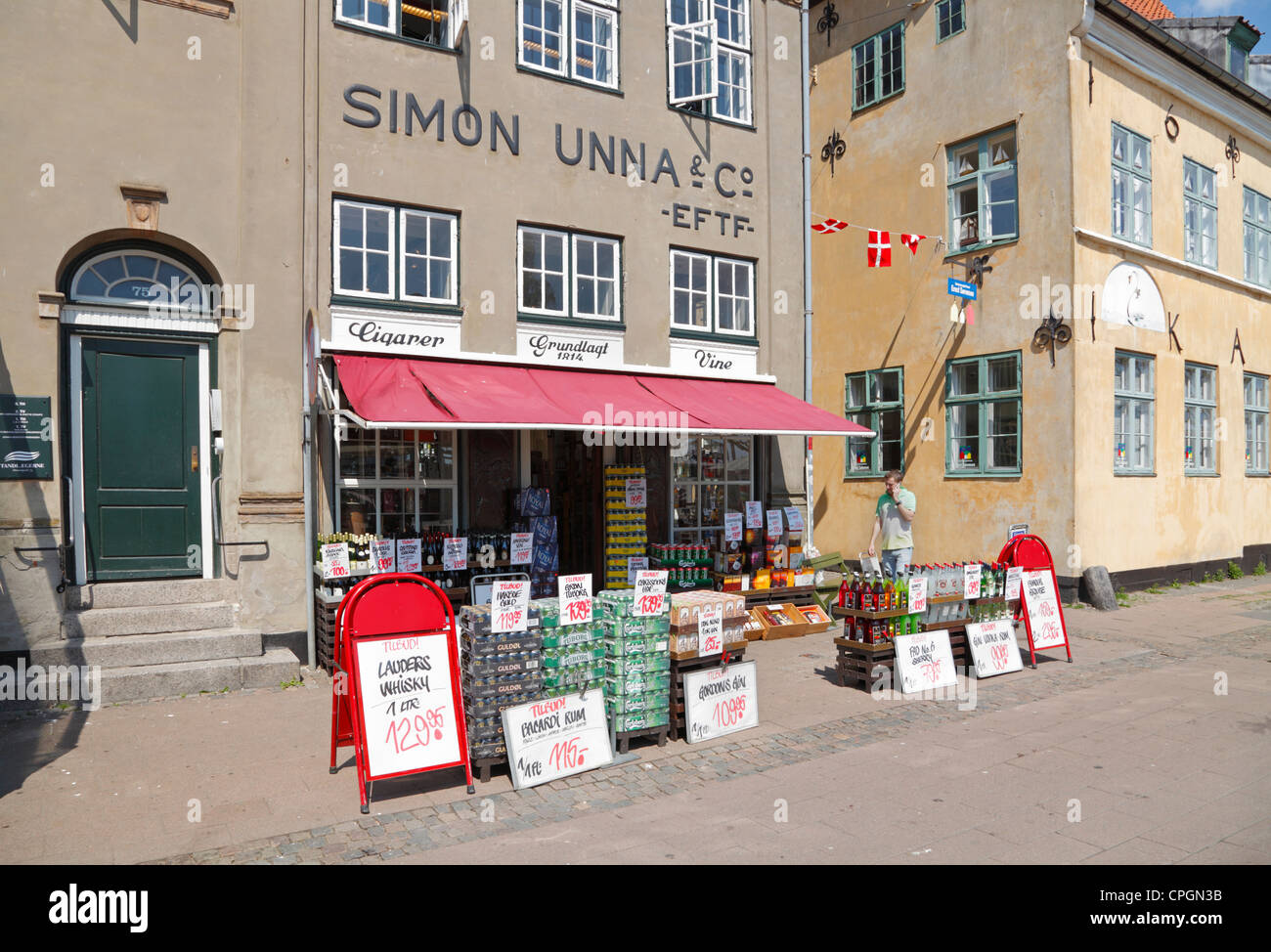 Beer, wine, and booze shop in historic town Elsinore, Denmark. Citizens from south Sweden buy alcoholic beverages - Stock Image