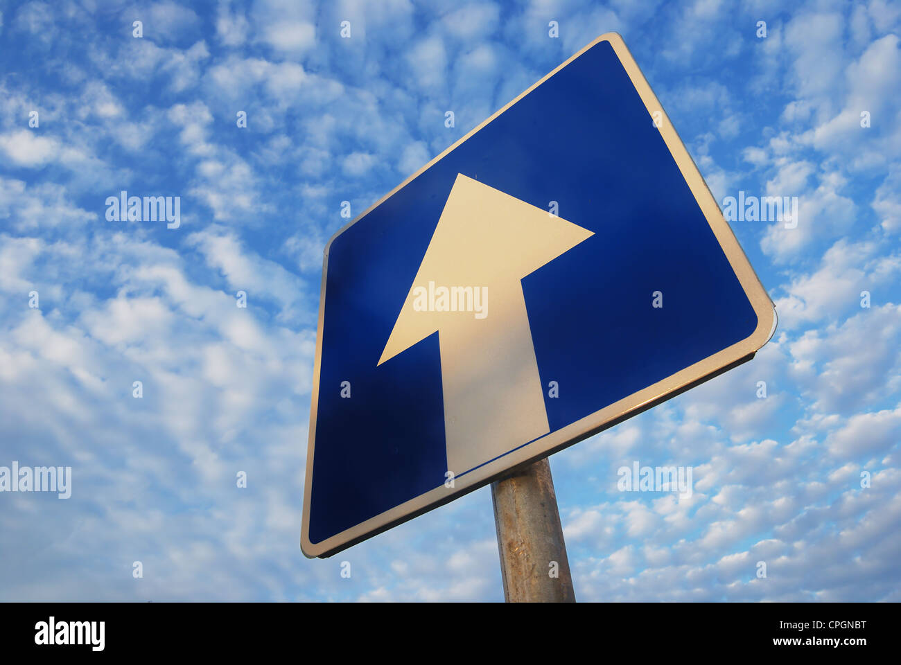one way sign under beautiful blue sky - Stock Image