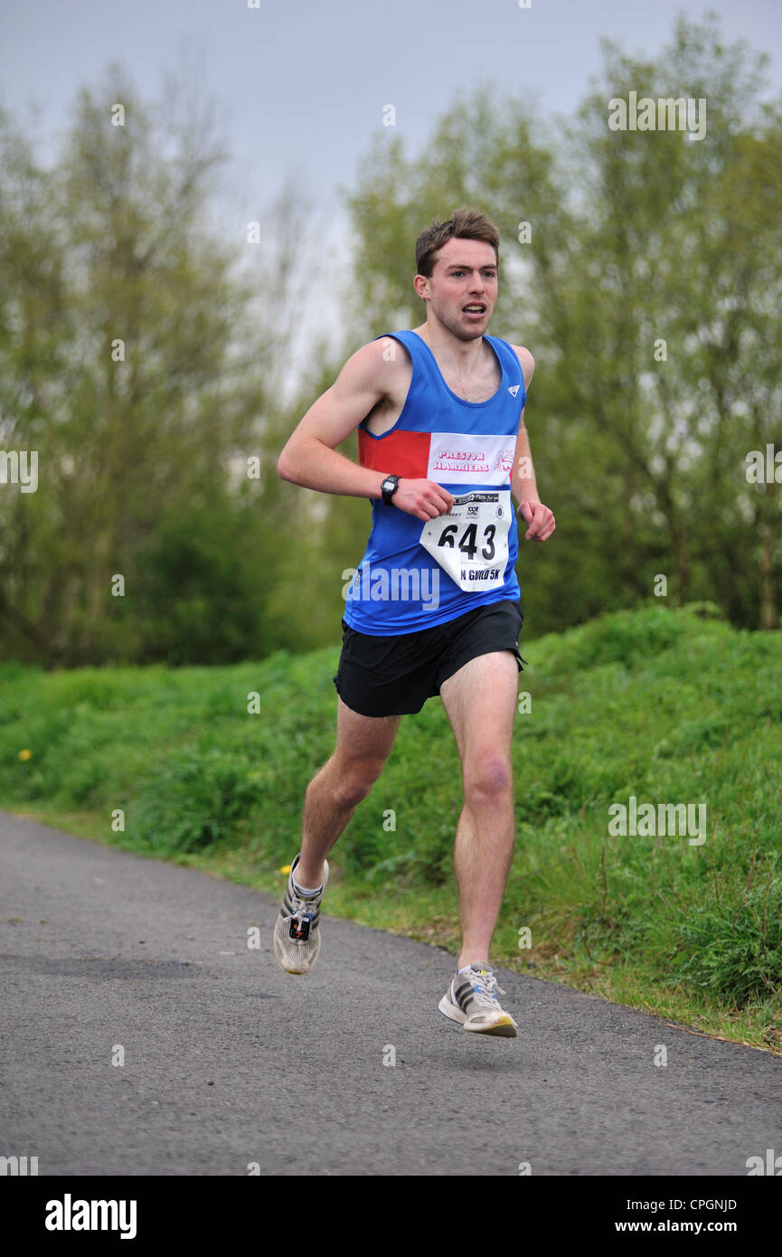 runner running in a road race Stock Photo