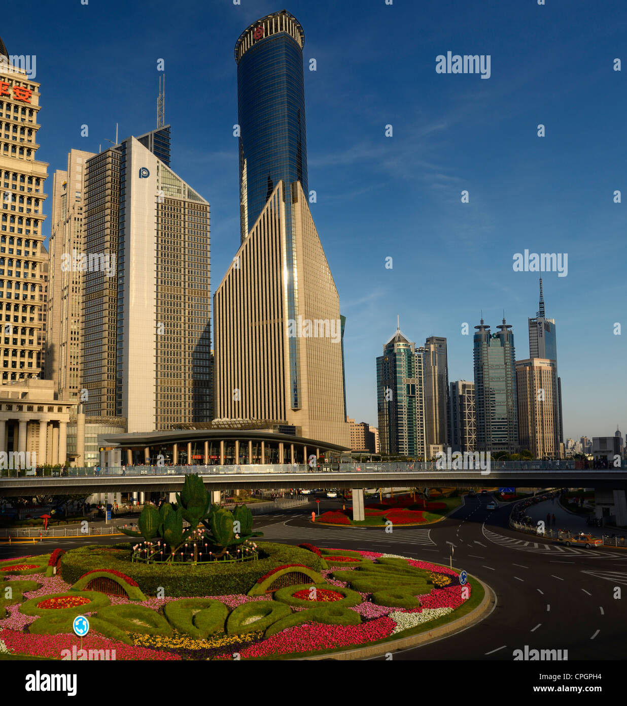 Three financial towers in the Pudong east side with garden roundabout in Shanghai China - Stock Image