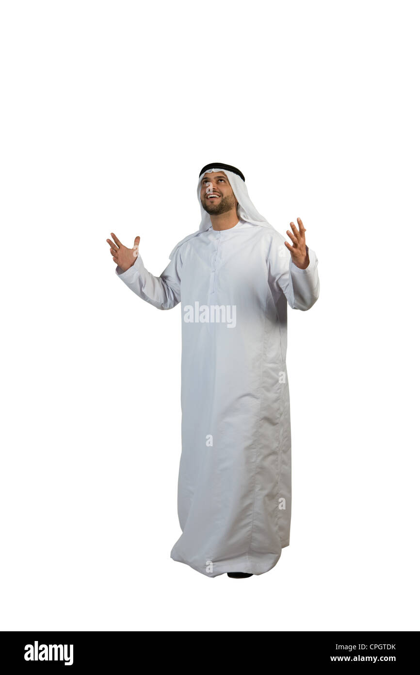 Arab man looking up with hands open Stock Photo