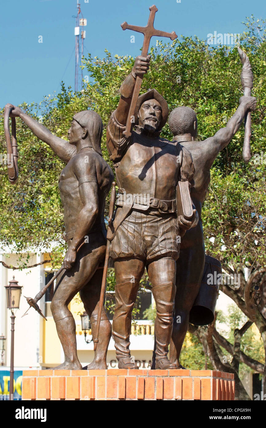 PUERTO RICO - Dorado - bronze sculpture showing Spanish, African and Taino heritage in town square. - Stock Image