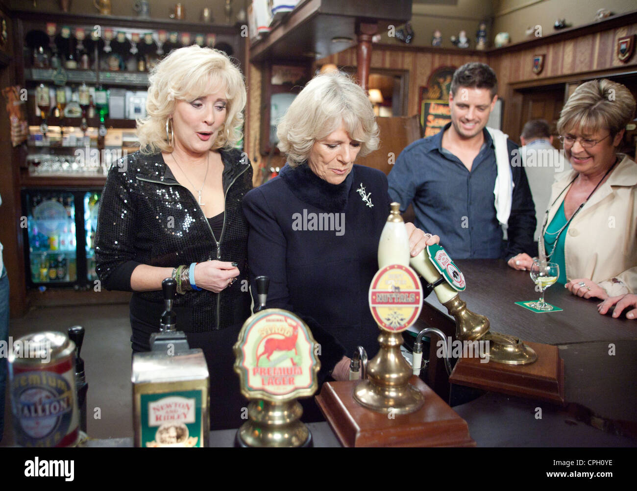 Dutchess of Cornwall pulls a pint in the Rover Return pub from ITV soap Coronation Street - Stock Image
