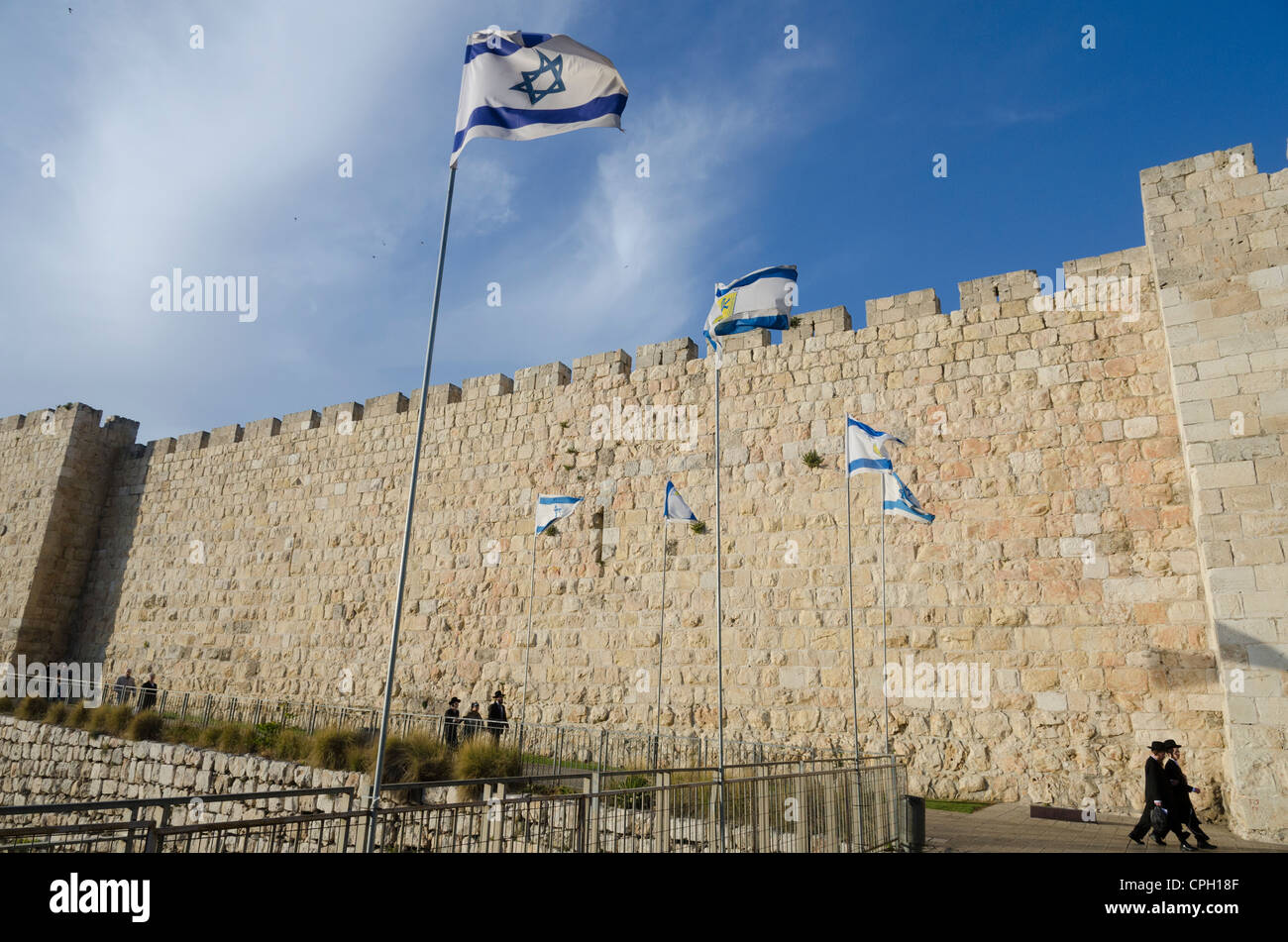 View of City Walls with orthodox jews and Israeli flag. Jerusalem Old City. israel. Stock Photo