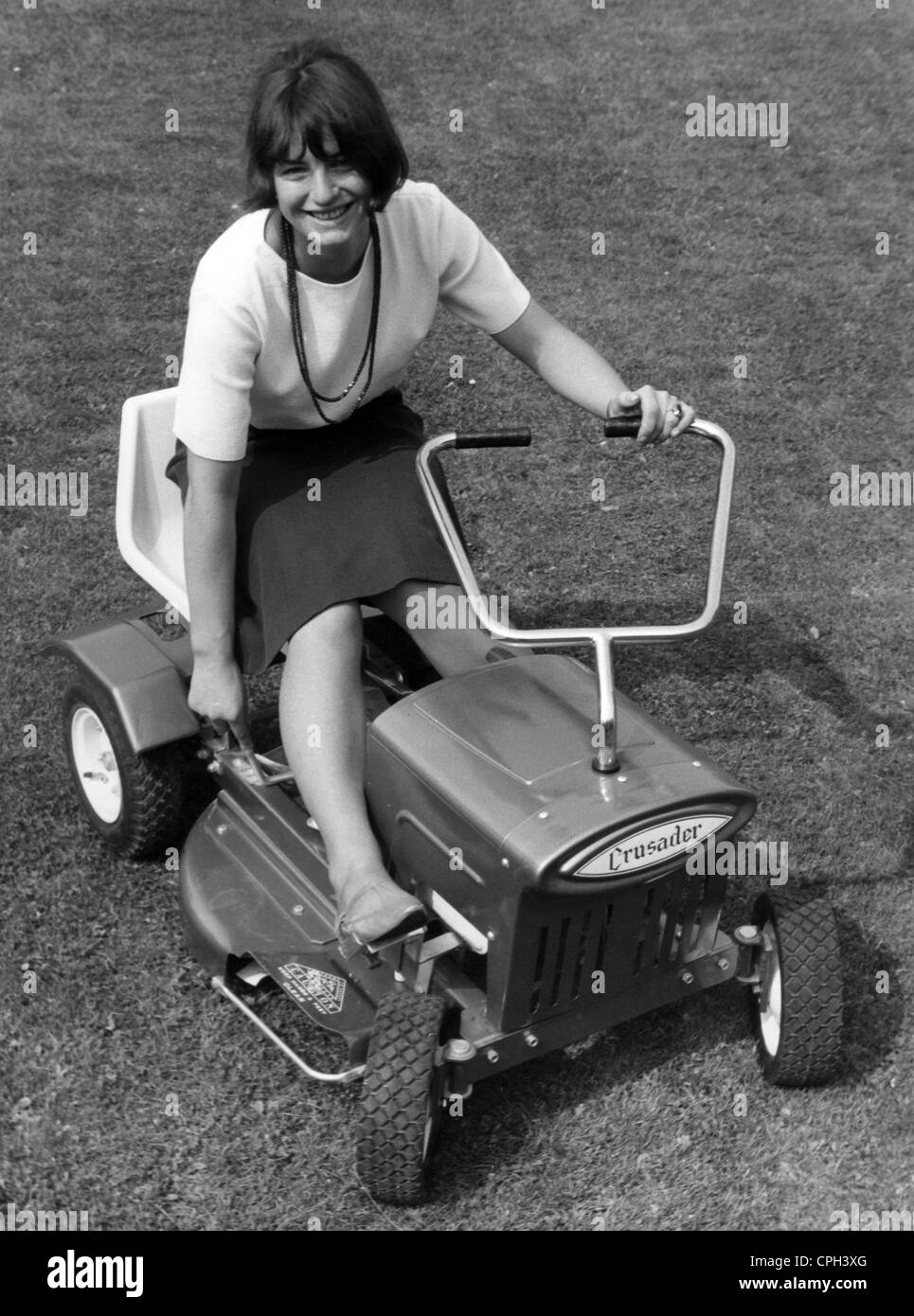 leisure time, gardening, woman on a 'Crusader' lawn mower, 1965, Additional-Rights-Clearences-NA - Stock Image
