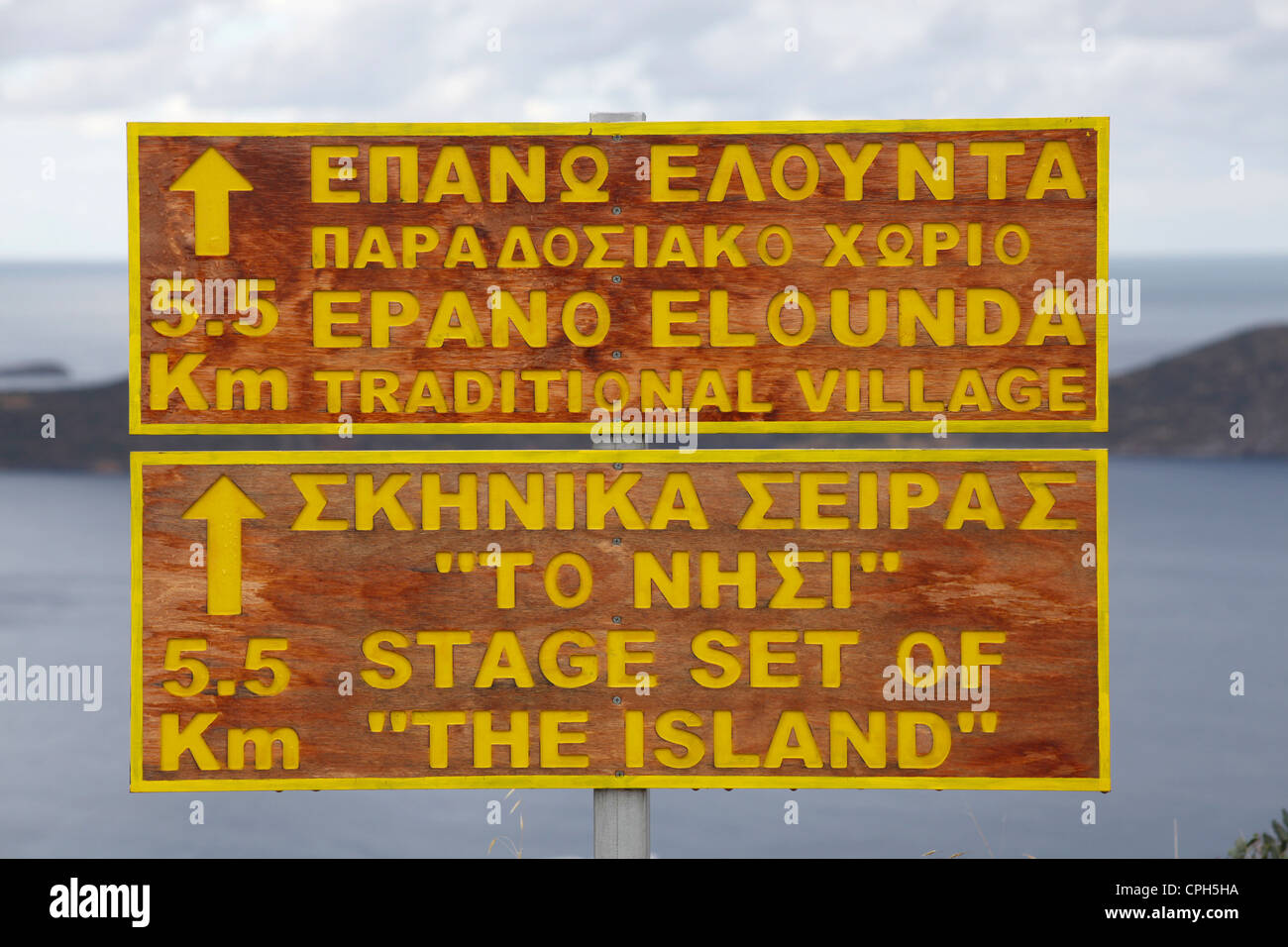 A Road sign in English and Greek language in the bay of Elounda at the north eastern Crete Island Greece - Stock Image