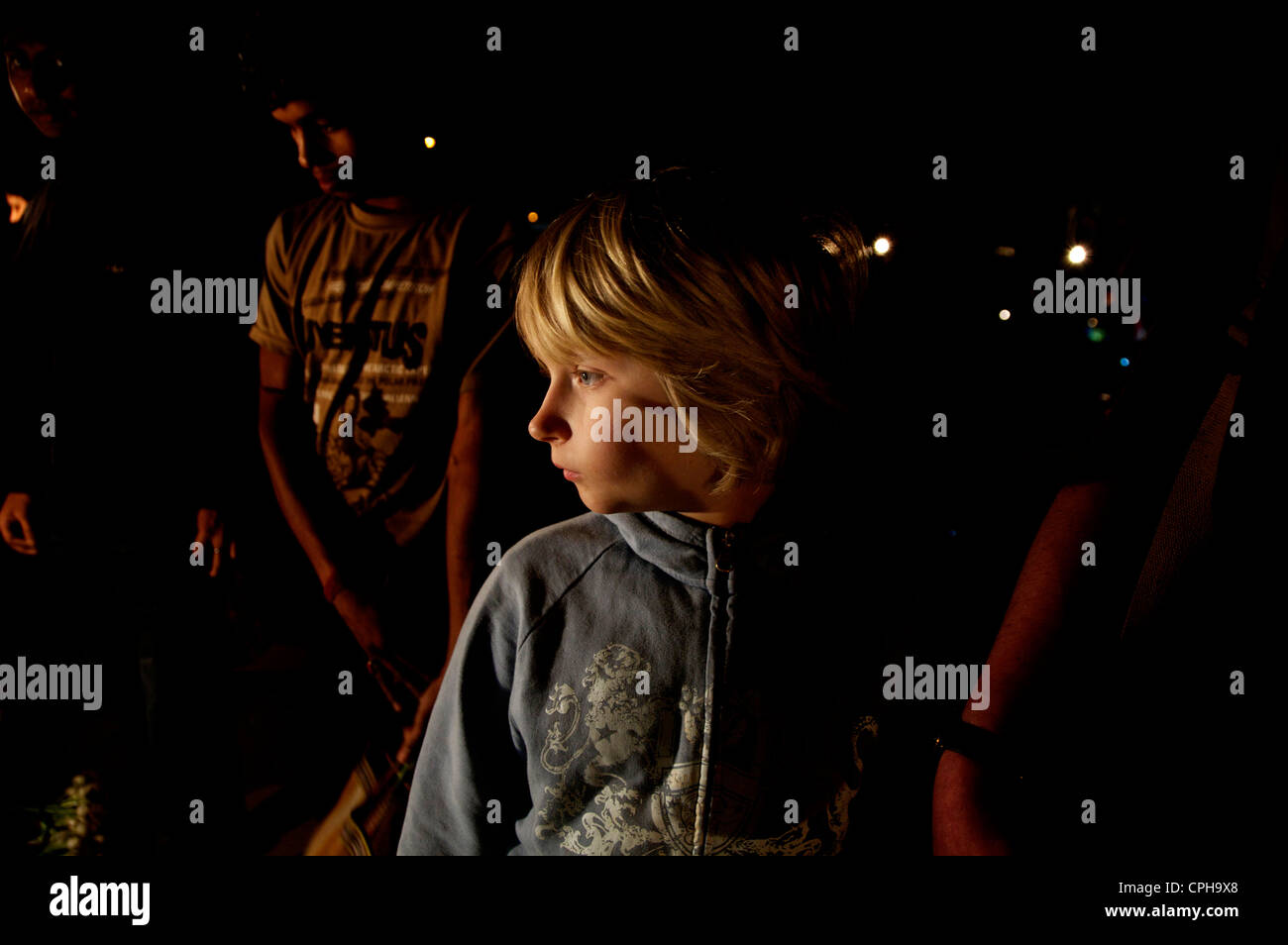 European boy on indian nightmarket - Stock Image