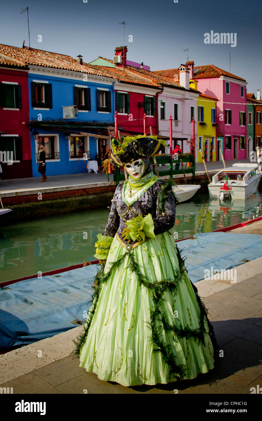 People in mask disguise in carnival. Burano island. Venice, Italy. - Stock Image
