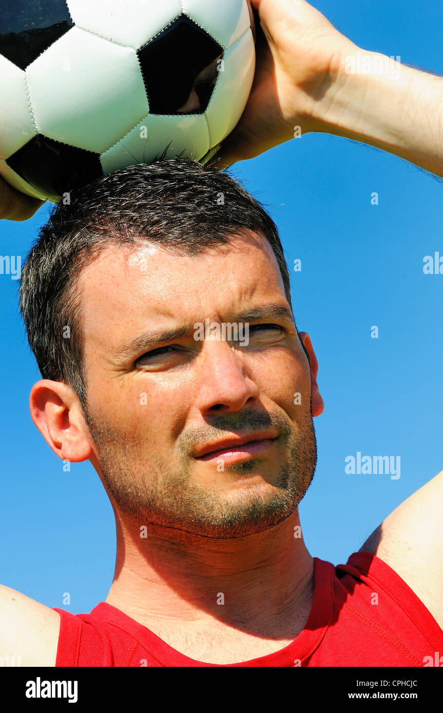 attractive football player with black and white balloon - Stock Image