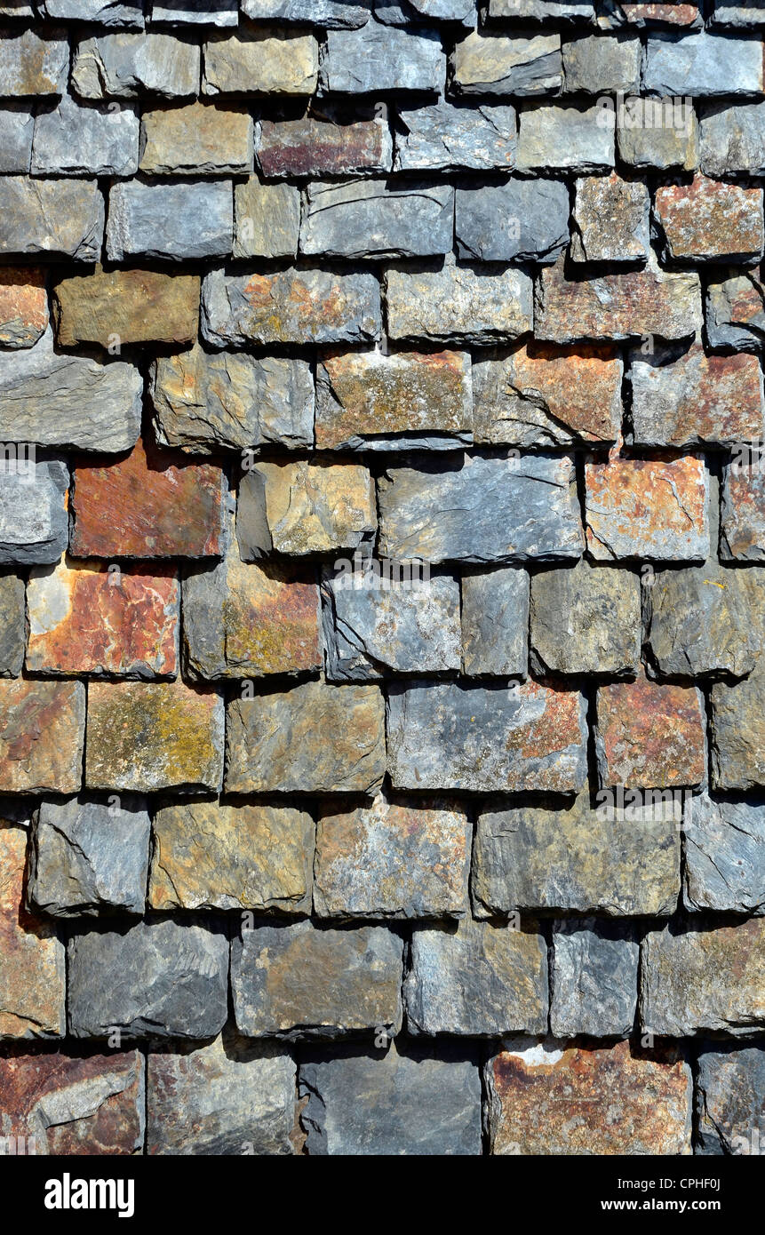 Wall covered with slate in Brittany in France - Stock Image