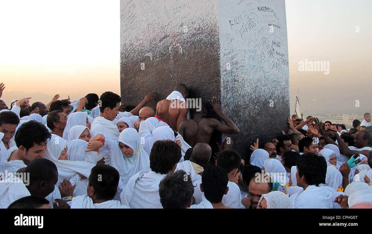 Pilgrims kissing Black Stone Al Hajar Al Aswad Mecca Saudi Arabia - Stock Image