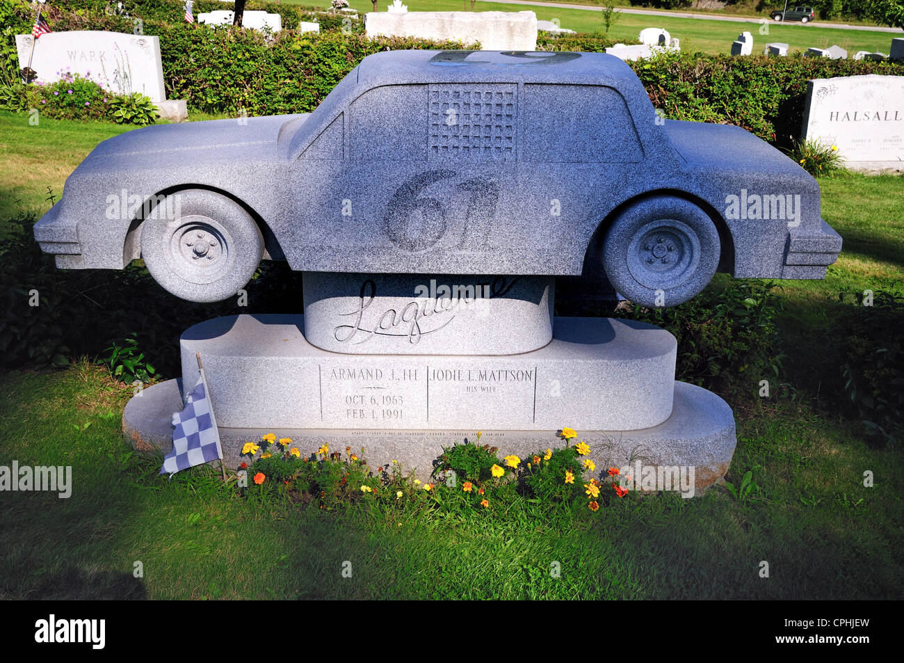 Giant sized gravestone in the shape of a racing car. The memorial is in Hope cemetery, Barre, Vermont - Stock Image