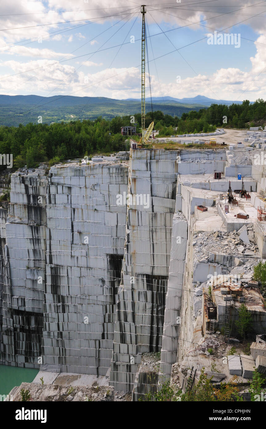 Tall cranes assist in excavation of granite at the Rock of Ages quarry, Barre, Vermont - Stock Image