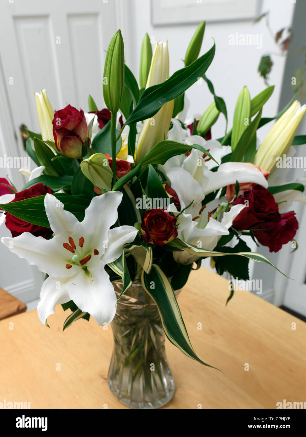 Bouquet Of Fairtrade Flowers Lillies And Roses In Vase On Kitchen ...