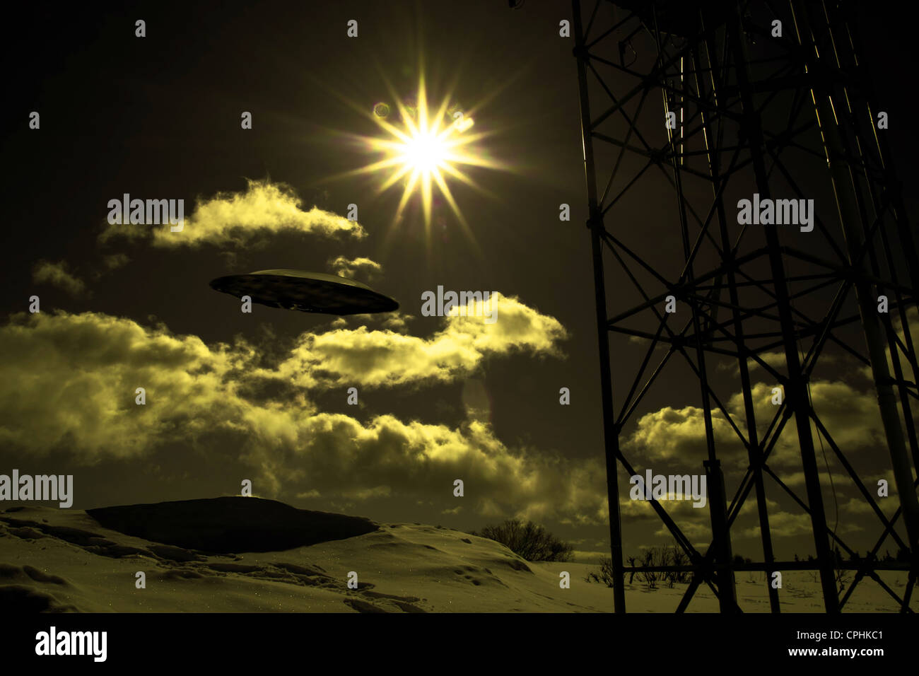 UFO in the sky near a communications tower with weird lighting. - Stock Image
