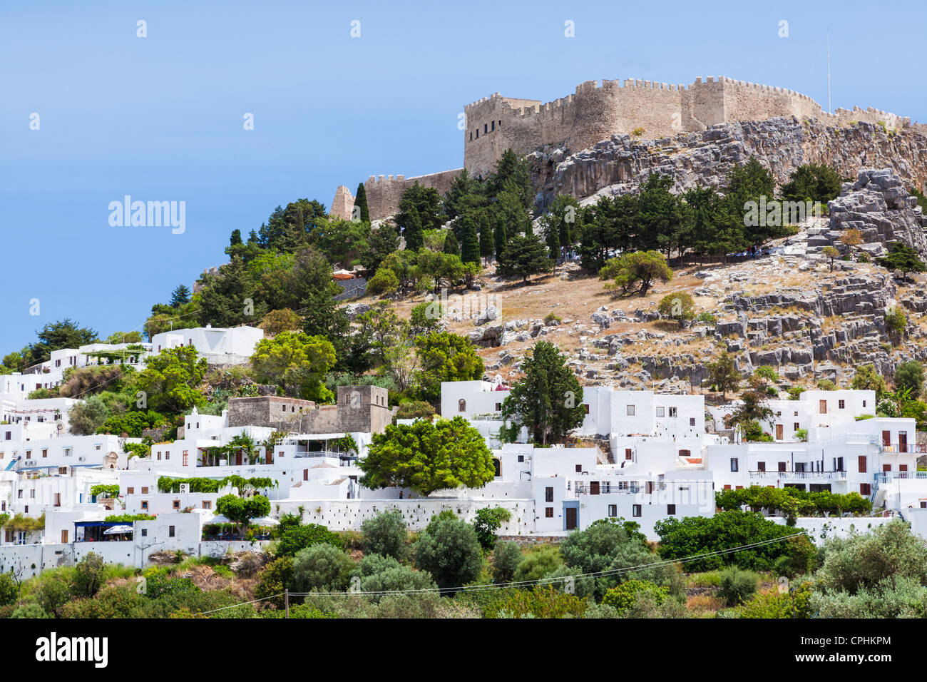 Lindos with the castle above on the Greek Island of Rhodes - Stock Image