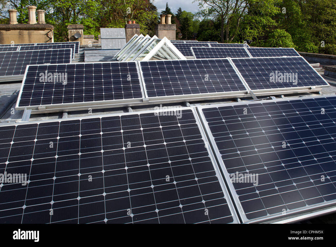 Solar panels on flat roof of private house, England - Stock Image