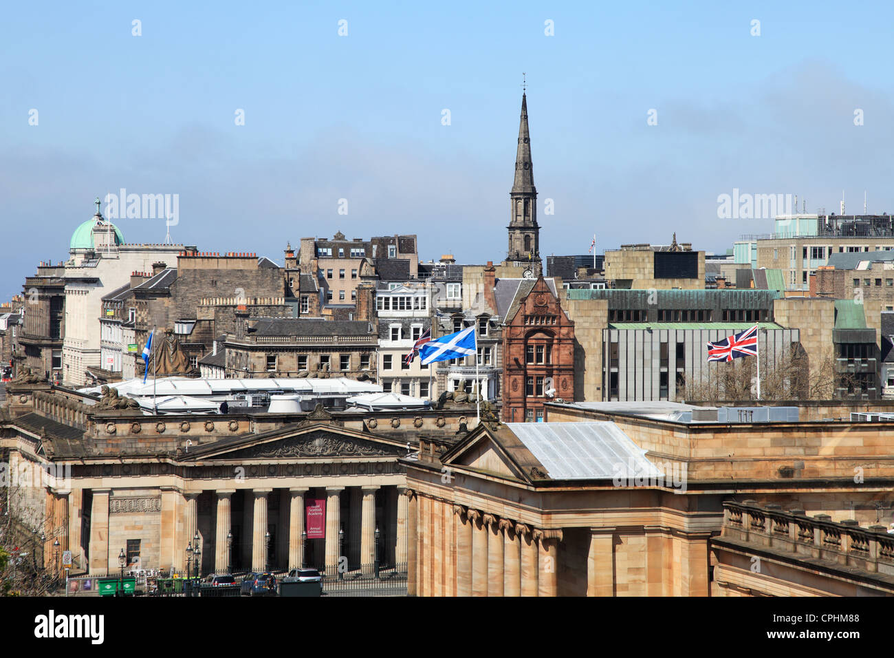 Edinburgh city skyline with Scottish and Union flags flying above the Scottish National Galley, Scotland UK - Stock Image