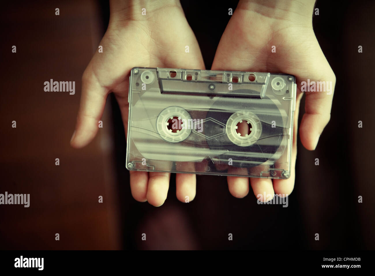 Boy holds old cassette tape. Stock Photo