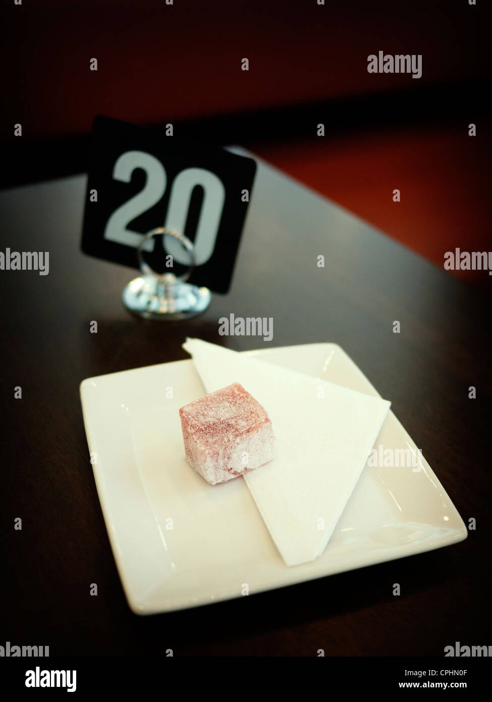 Lump of Turkish delight on plate in cafe. - Stock Image