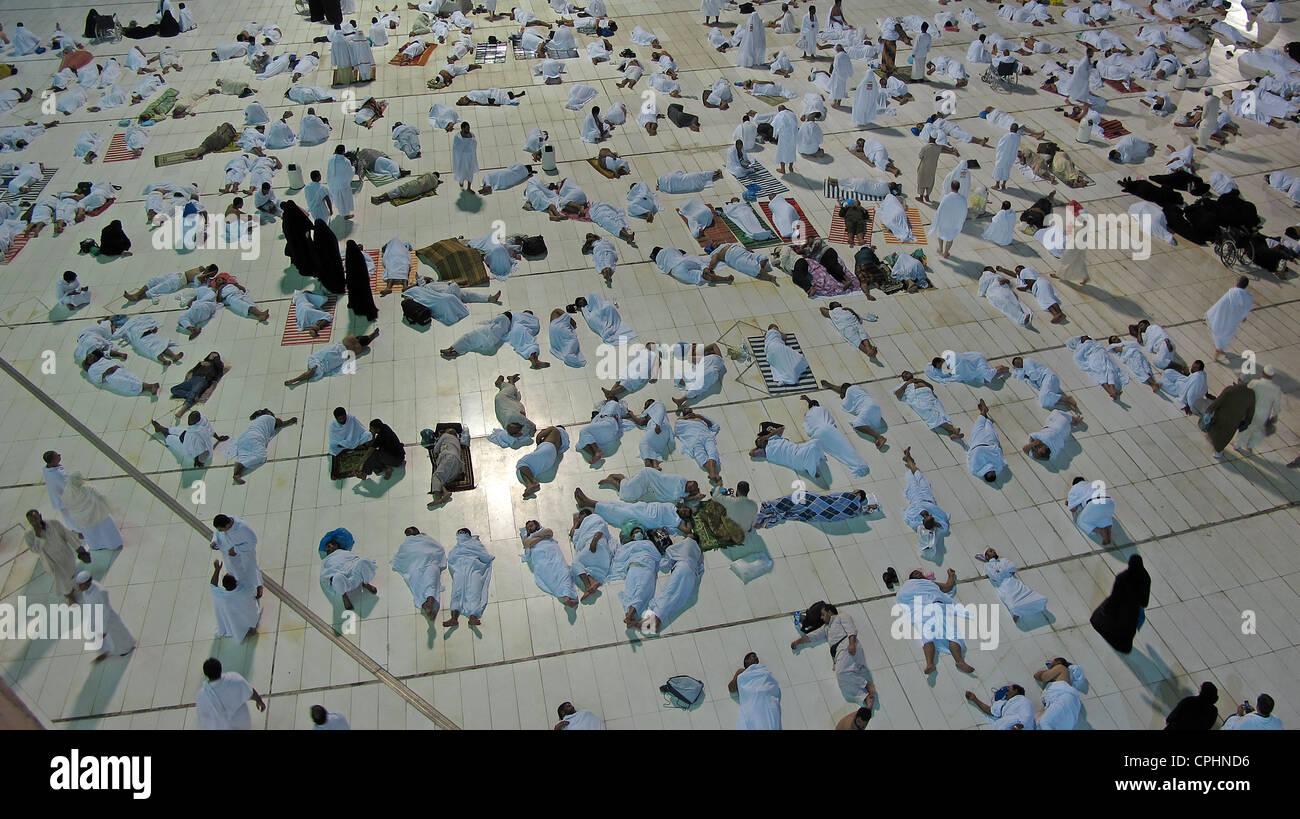 Muslim pilgrims resting in Al Haram mosque Mecca Saudi Arabia - Stock Image