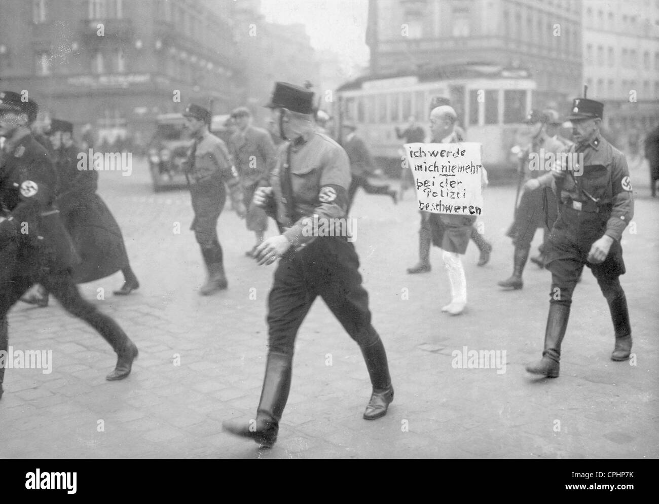 Jewish attorney Michael Siegel directed barefoot through the city streets under SS escort, with his trousers cut - Stock Image