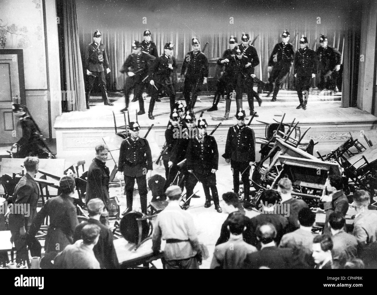 A brawl between Communists and National Socialists at a political meeting, broken up by policemen, 1929-32 (b/w - Stock Image