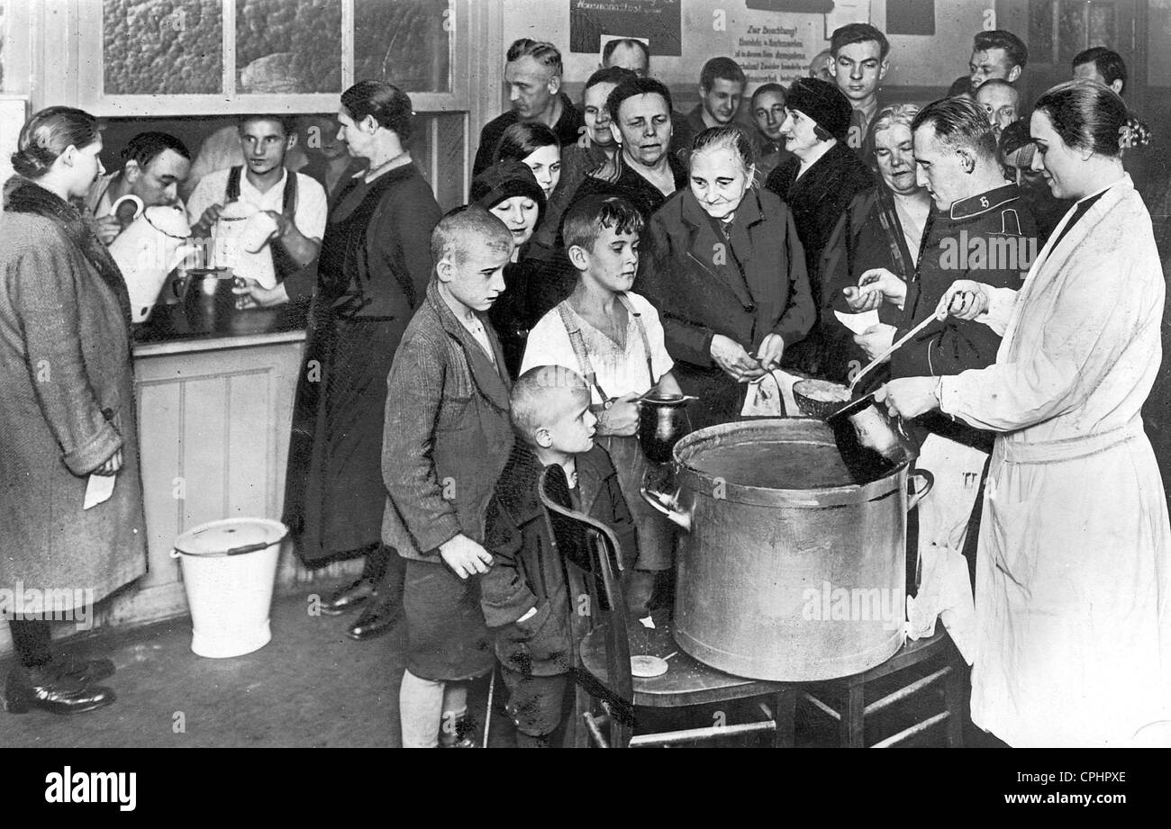 Families receive a warm meal in a Salvation Army soup kitchen in ...