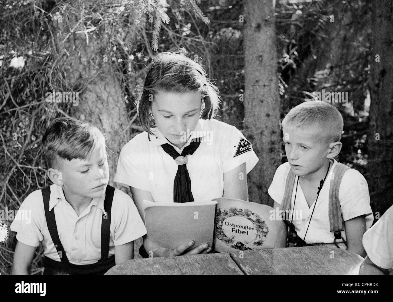 BDM girl looks after children, 1943 - Stock Image