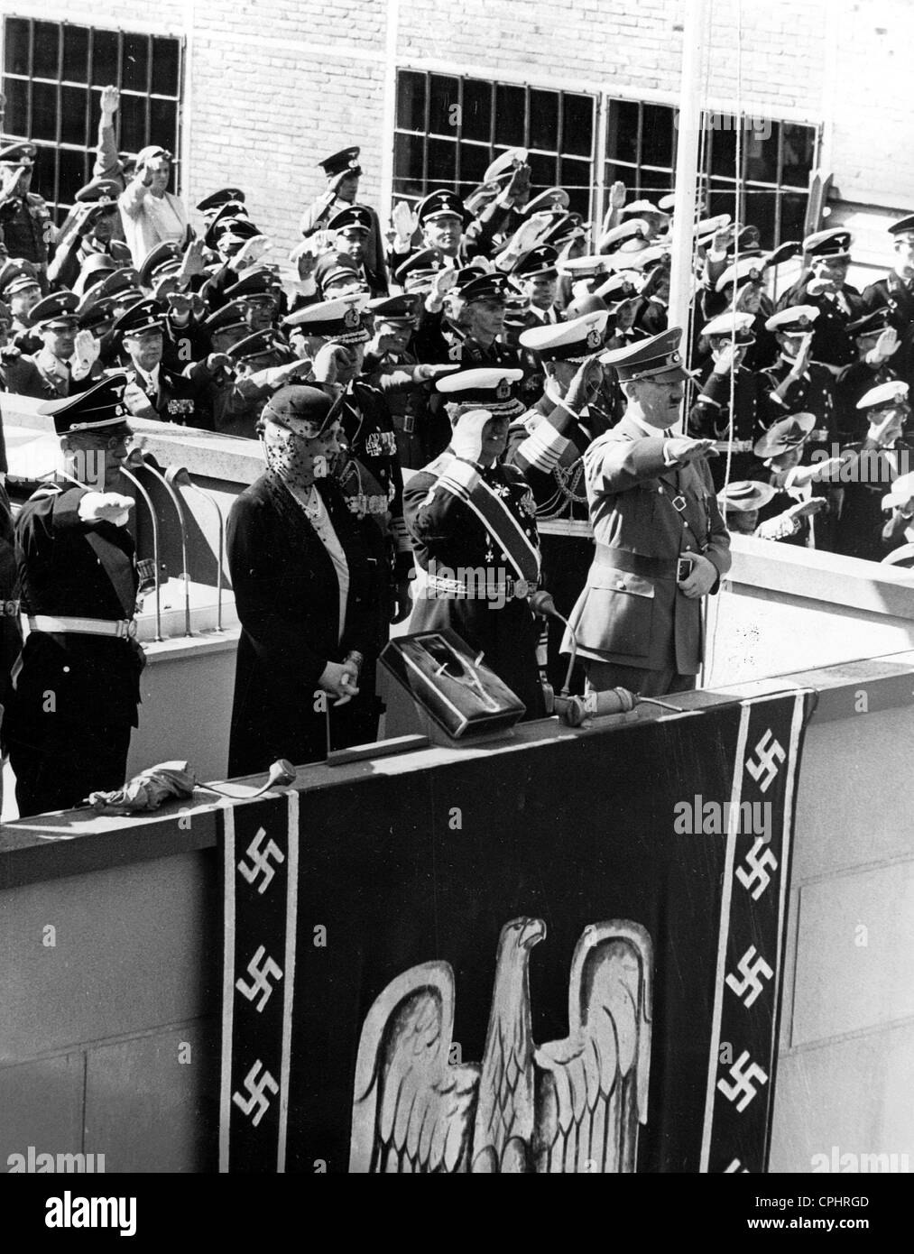 View of Adolf Hitler and Nazi naval leaders at the launch of the German heavy cruiser 'Prinz Eugen', 1938 - Stock Image
