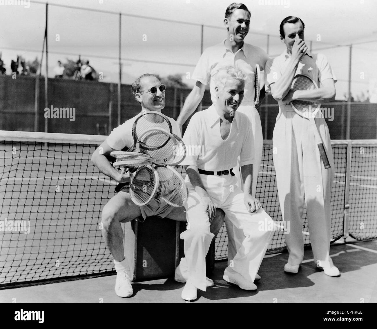 Groucho Marx, Charles Chaplin, Ellsworth Vines and Fred Perry, 1937 - Stock Image