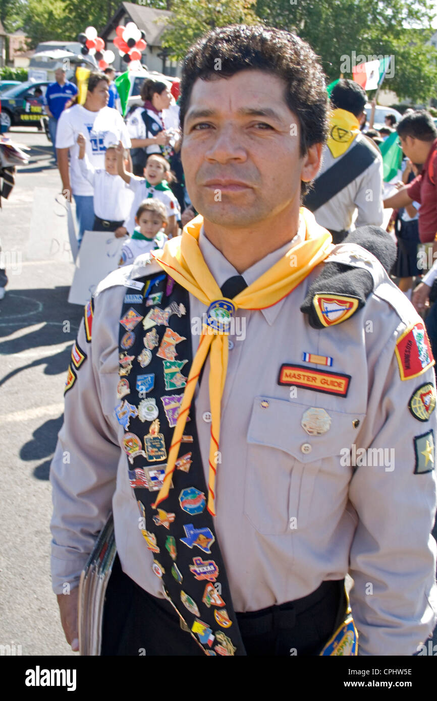 Mexican American Boy Scout Leader wearing sash of merit badges at parade. Mexican Independence Day Minneapolis Minnesota - Stock Image