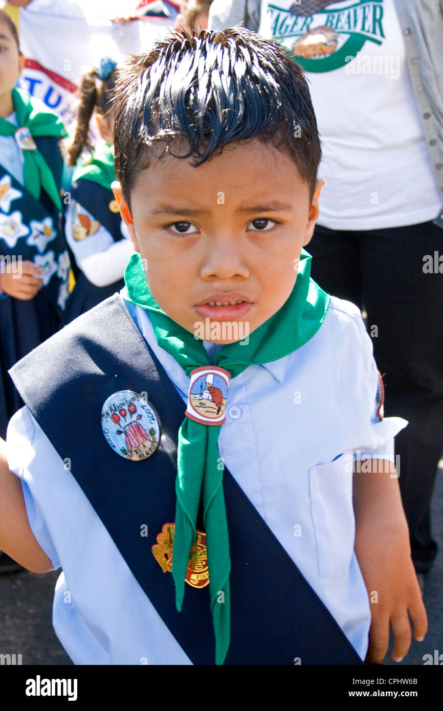 Young Mexican American Cub Scout wearing sash of merit badges in parade. Mexican Independence Day Minneapolis Minnesota - Stock Image