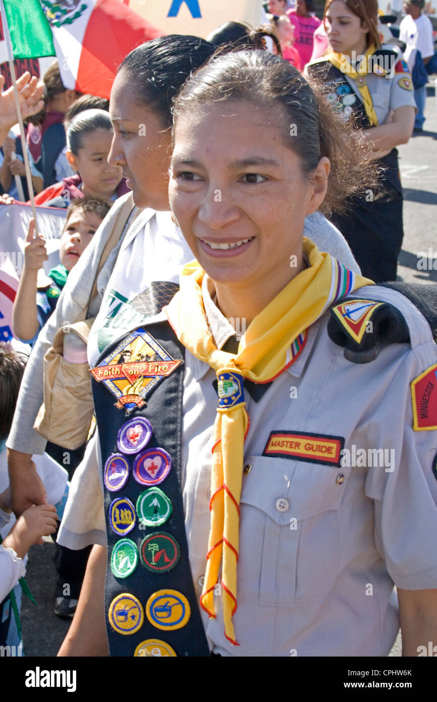 Mexican American Girl Scout Leader wearing sash of merit badges in parade. Mexican Independence Day Minneapolis - Stock Image