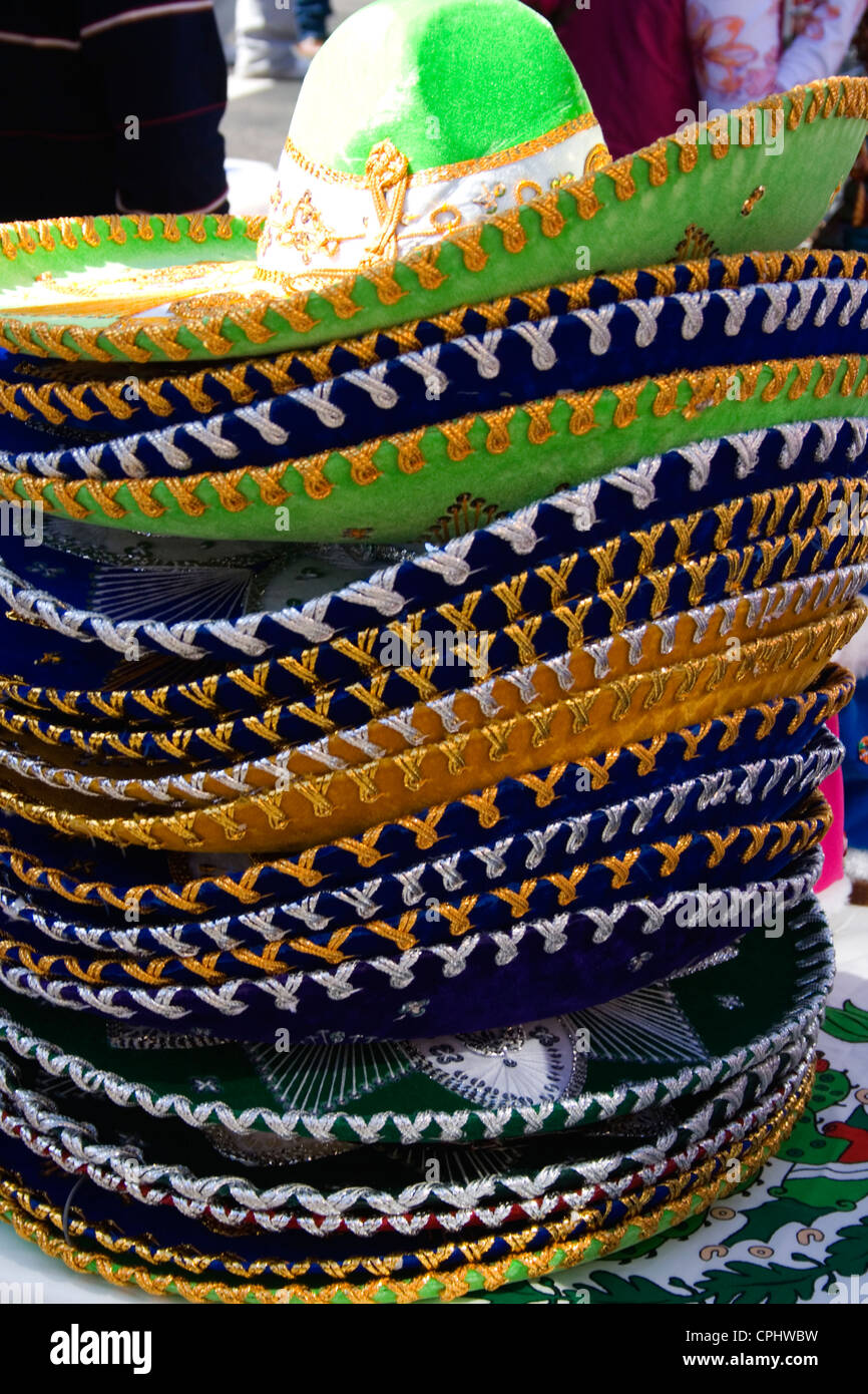 Stack of colorful Mexican sombreros for sale at sidewalk shop. Mexican Independence Day Minneapolis Minnesota MN Stock Photo