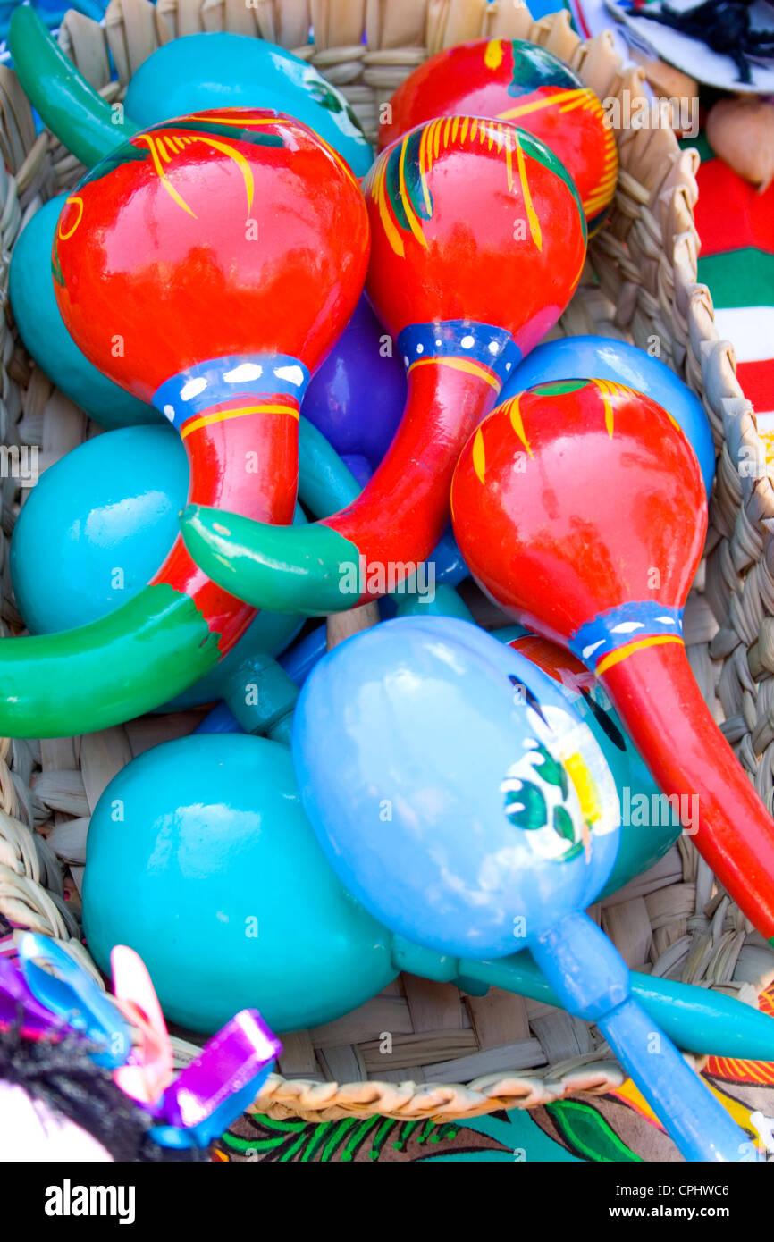 basket of colorful mexican maracas for sale at fiesta sidewalk shop