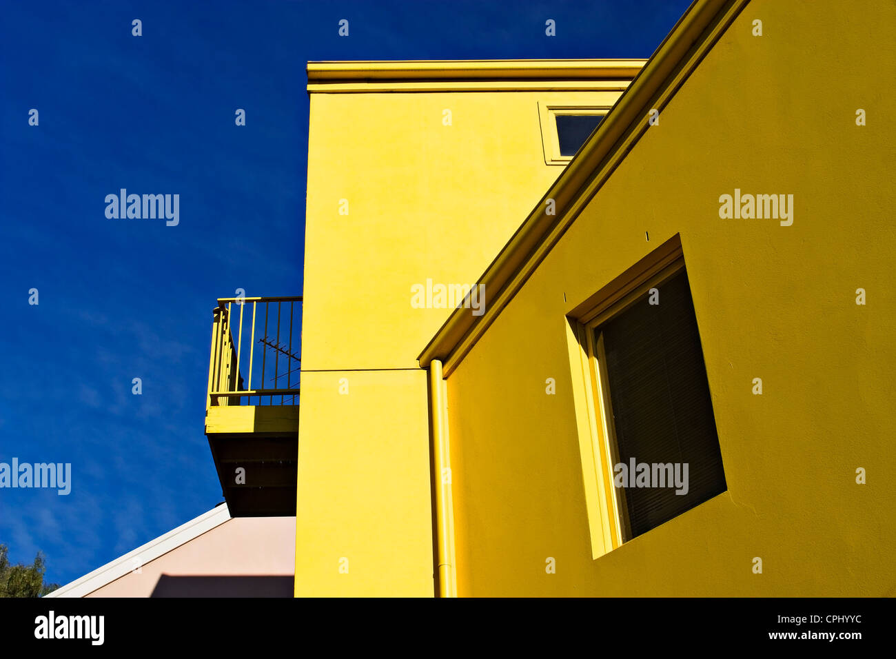 This bright yellow contemporary townhouse is located in the Melbourne suburb of Flemington. - Stock Image