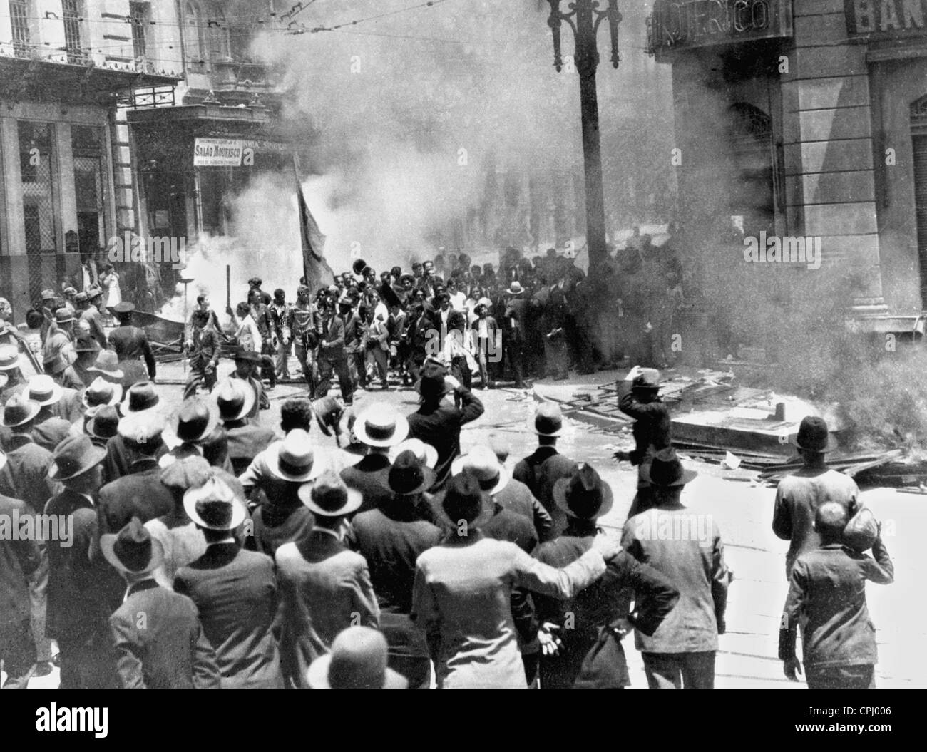 Insurgents set a newspaper publishers on fire, 1930 Stock Photo