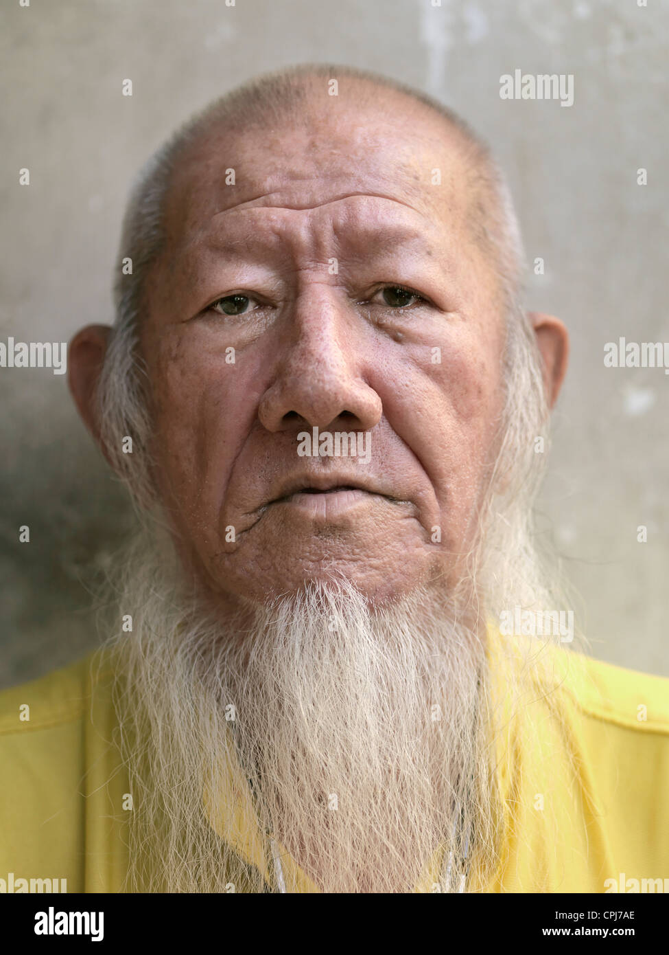 Portrait of a old Chinese Fortune Teller with a long beard - Stock Image
