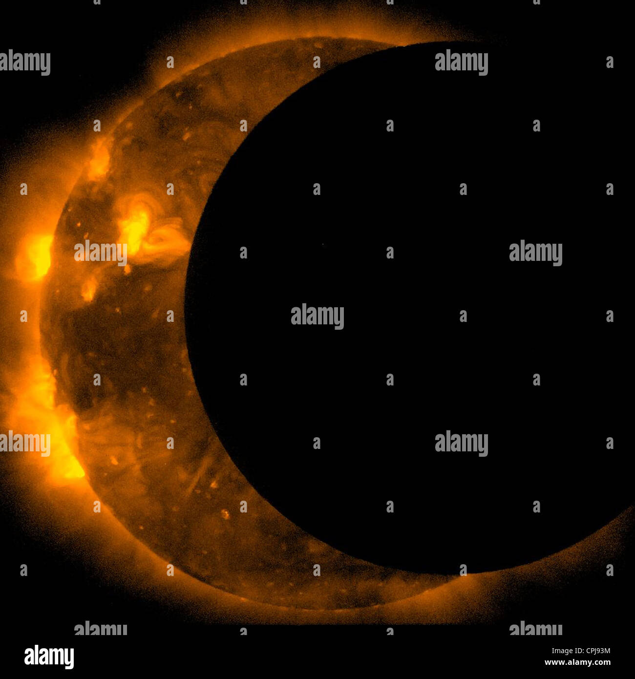 Image captured in space of the annular eclipse of the Sun taken by the Hinode mission May 20, 2012.  During - Stock Image