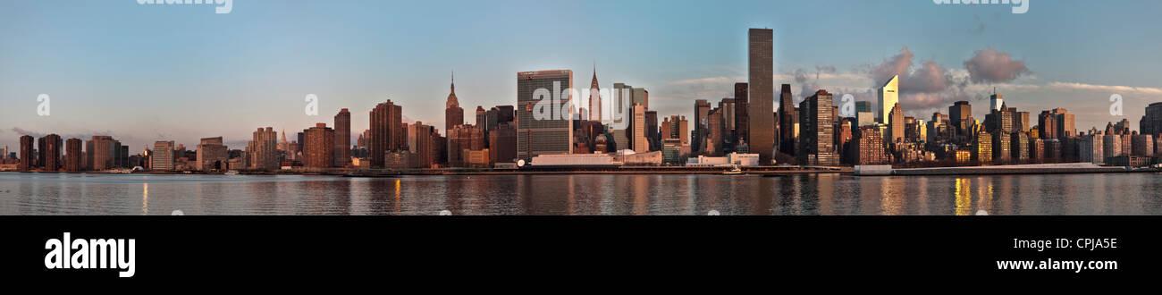 New York City skyline of Midtown Manhattan at sunrise, viewed from Gantry Park in Brooklyn, New York City. Stock Photo