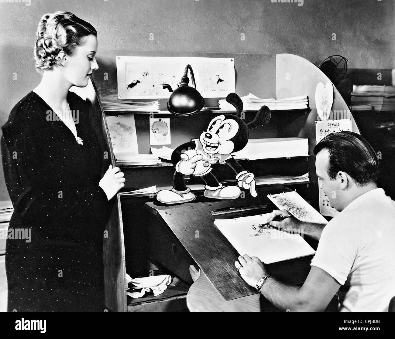 Phyllis Brooks, Tex Avery and the cartoon character Oswald, 1934 Stock Photo