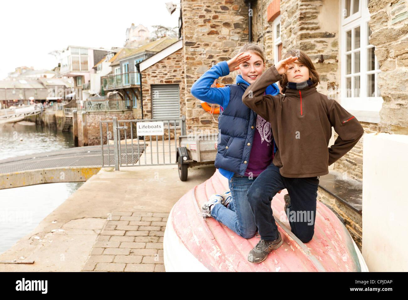 children sitting on boat - Stock Image