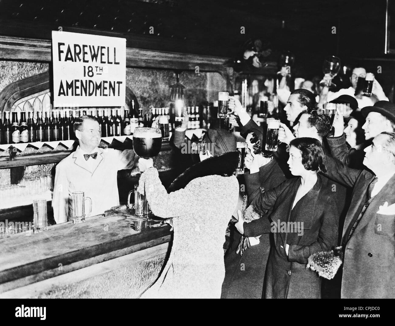 In a bar in New York, the abolition of the 18th Amendment of the U.S. Constitution (18th Amendment) is celebrated. - Stock Image