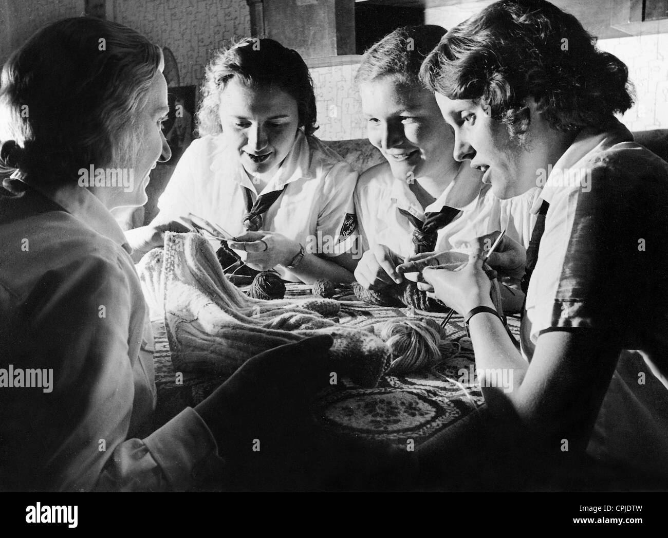 BDM girls while collective needlework - Stock Image