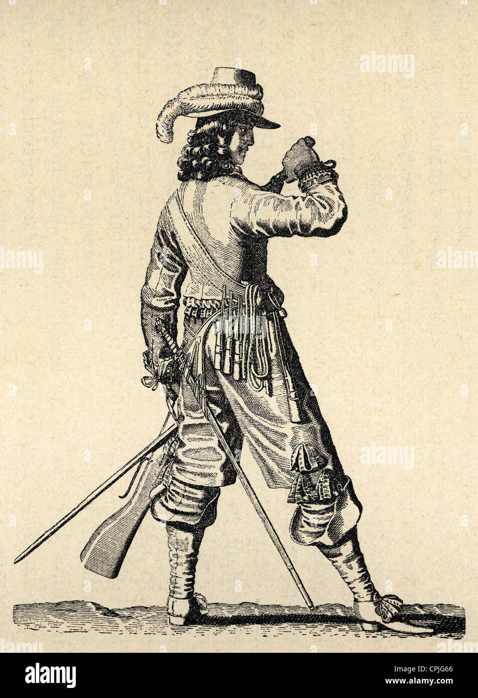 Army of the 18th century. France. Musketeer of the Infantry of Louis XIV charging the musket. Engraving. - Stock Image