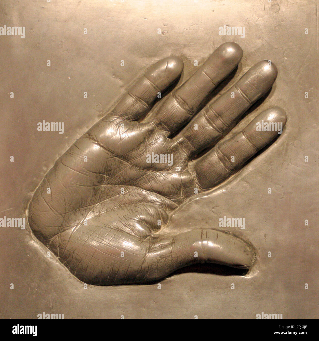 An imprint of a hand in metal in the wax works Madame Tussauds, Berlin, Germany - Stock Image
