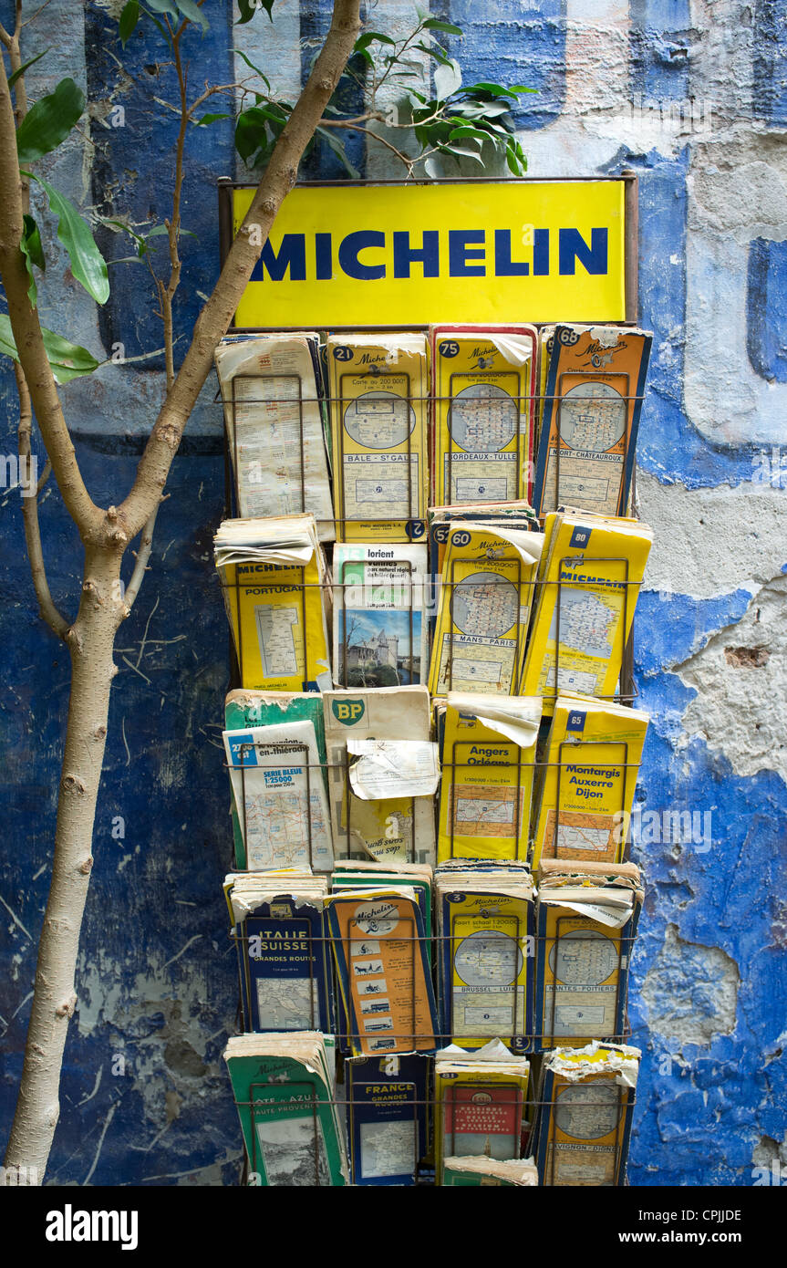 A Display Rack Of Old Worn Michelin Road Maps Stock Photo