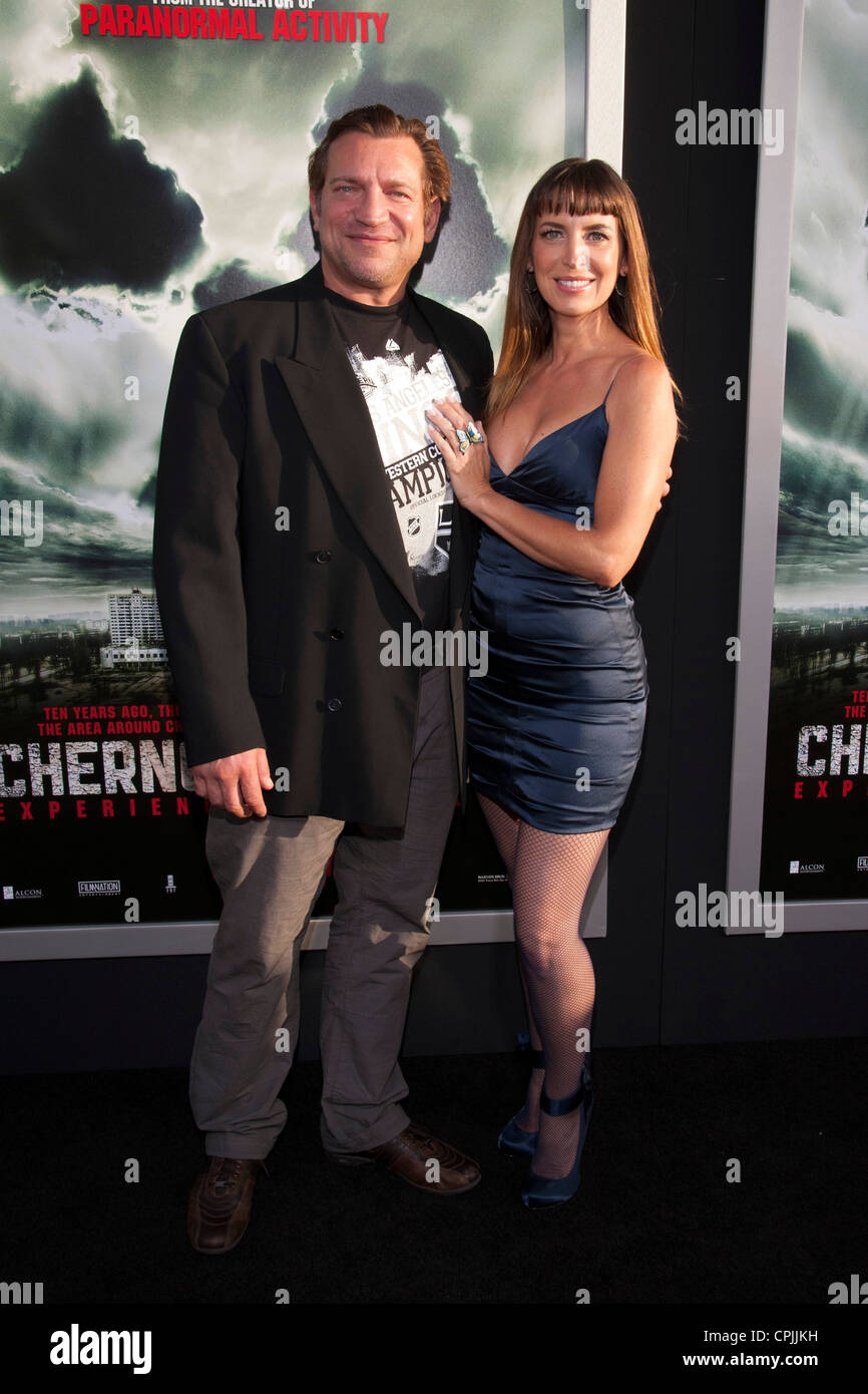 Dimitri Diatchenko and Sondra Vigal pose at the Special Fan Screening of Chernobyl Diaries at the Cinerama Dome - Stock Image