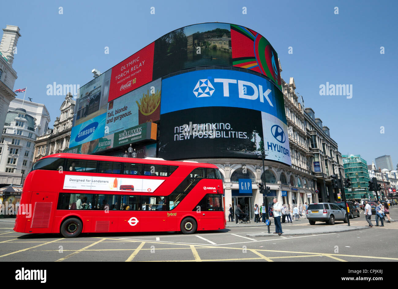 New Routemaster bus passes through Piccadilly Circus, London - Stock Image